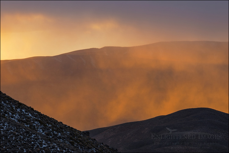 Image: Sunset light on misty clouds at Aguereberry Point, Death Valley National Park, California