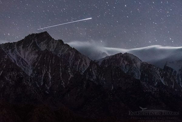 A streak of UFO light in the night sky over the mountains of the Eastern Sierra, near Lone Pine, California