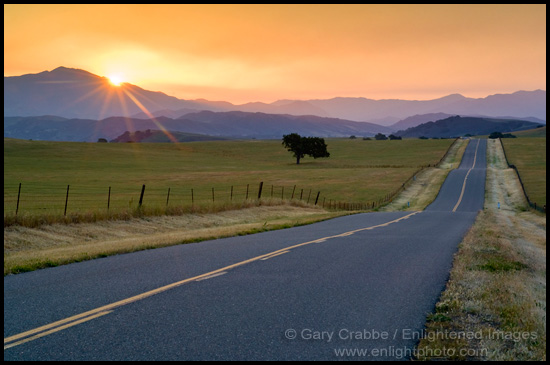 stock photo golden sunrise over long straight country